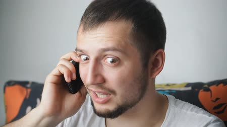 сердитый : angry man at the phone, angry phone call Стоковые видеозаписи