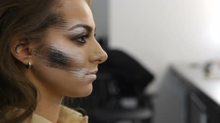 supermodel : profile of girl model with extreme make-up in a beauty salon Stock Footage
