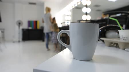 supermodel : cup with tea or coffee in the make-up studio or beauty salon
