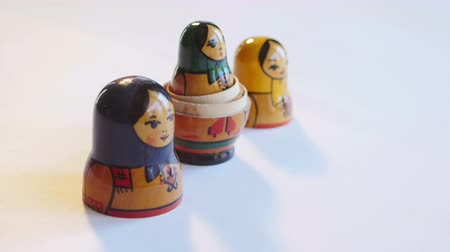 aninhada : Matryoshka Doll rotates on a white background in 4k Vídeos