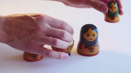 aninhada : Man parses Matryoshka Doll on a white background in 4k