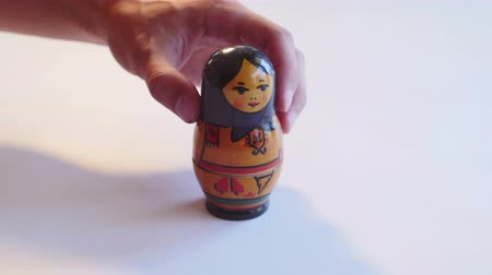 aninhada : Russian Matryoshka Doll rotates on a white background in 4k