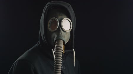 hazmat : portrait of a man in a hood with gas mask covering his face.