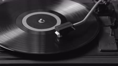 tonearm : Black and white shot of a record player playing vinyl. Retro Vinyl Turntable Stylus Stock Footage