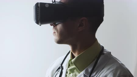 prescribe : Doctor uses a virtual reality glasses. Stock Footage