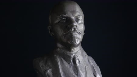 ulyanov : spinning portrait sculpture of Vladimir Lenin on black background.
