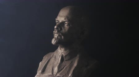 ulyanov : Spinning portrait sculpture of Vladimir Lenin on black background. Era of the USSR