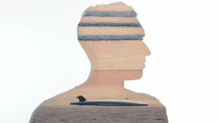 Double exposure of man and oceanic sunset with surfboard on beach. Double exposition of man and ocean waves