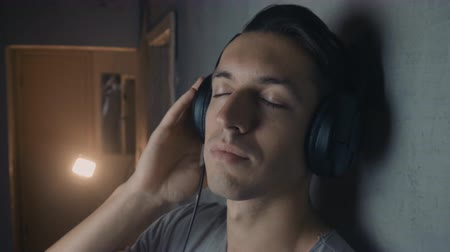 Close up of Young man with headphones listening music Dostupné videozáznamy