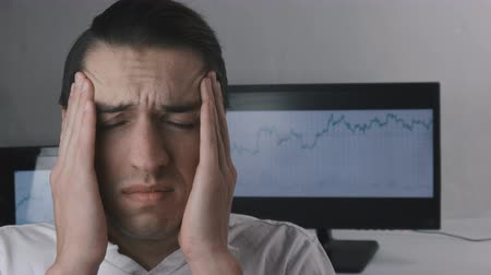 annoyance : Tired Businessman have headache and feel discomfort at workplace.