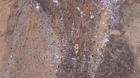 Aerial view of Garbage dump landfill. Trash trucks dump waste products polluting in a trash dump.Black birds flocks over the garbage dump. Dostupné videozáznamy