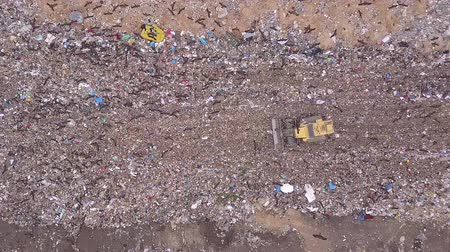 tüketici : Aerial view of Garbage dump landfill. Trash trucks dump waste products polluting in a trash dump.Black birds flocks over the garbage dump. Stok Video