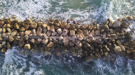fisherman : Aerial view of a Fishermen are standing on a breakwater. Stock Footage