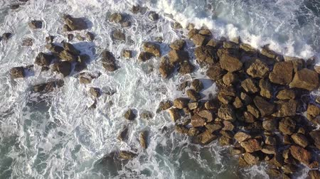 aegean sea : Ocean waves are breaking on a Breakwater at winter sea. Aerial top down view.