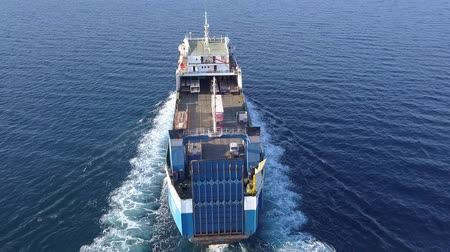 rulolar : Ro Ro Ship: Aerial view of a medium RoRo Vehicle carrie vessel cruising at sea. Stok Video