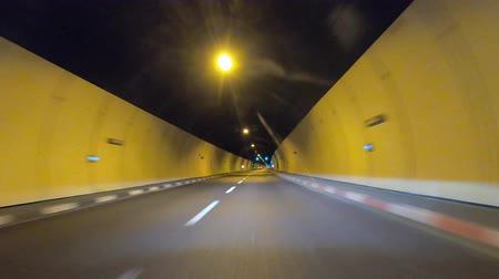 singapur : Tunnel Driving : Car driving through a road tunnel. Stok Video