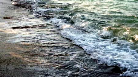 el değmemiş : beautiful evening waves on the beach, covered with coarse sand