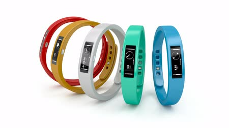 pedometer : Fitness trackers with different interfaces and colors Stock Footage