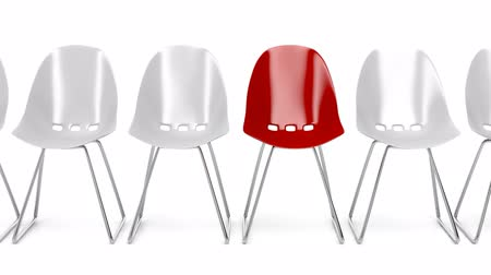 стулья : White plastic chairs and one unique red chair