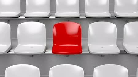 diferença : Unique red seat at the stadium Stock Footage