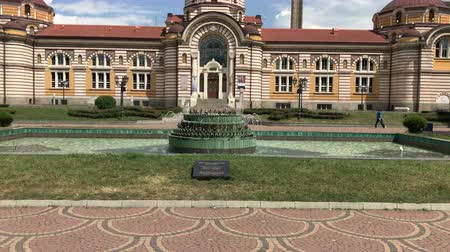 bathhouse : SOFIA, BULGARIA - MAY 28, 2018: Fountain in front of the Central mineral baths building, one of the main landmarks in Sofia, Bulgaria