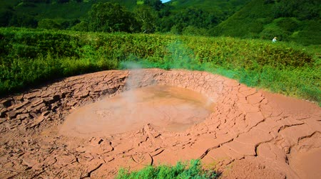 Mud pots in Valley of Geysers. Tourist season in Kamchatka Peninsula. Kronotsky Nature Reserve. The summer stock footage video