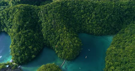 přímořská krajina : Aerial view flying over the beautiful and tropical green mountains Sugba Lagoon in Siargao, Philippines