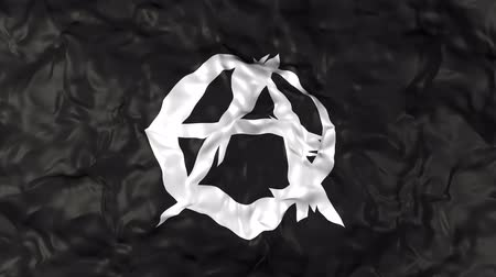 tópicos : Close-up of a flag with an anarchy symbol waving
