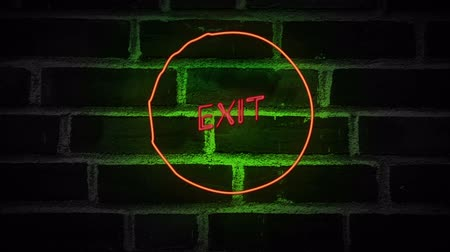 jelenség : Flickering blinking red neon sign Exit on brick wall background