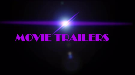 algılayıcı : Lens flare on black background with text MOVIE TRAILERS, movie industry Stok Video