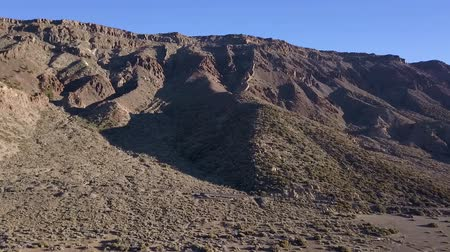 kanarya : Mountain aerial view of the Teide National Park of Tenerife, drone shot along the wild in Canary Islands Stok Video