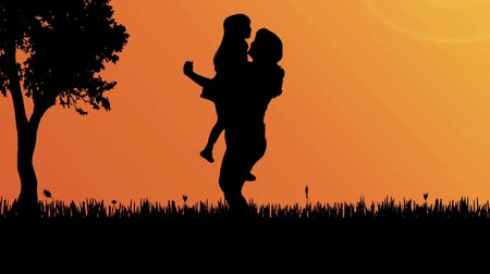 small park : Silhouette family in a park at sunset.