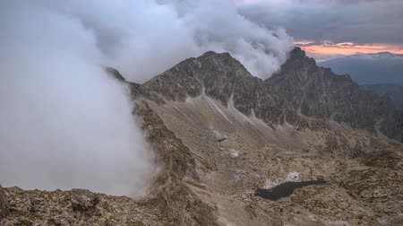 kráter : Clouds cover the mountains after sunset 4K Time Lapse Stock mozgókép