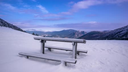 picnic table in the mountains in winter clouds stream 4K Time Lapse