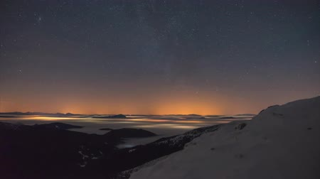 4K. Time-lapse of night sky with clouds and stars crossing the mountains of High Tatras. Dostupné videozáznamy
