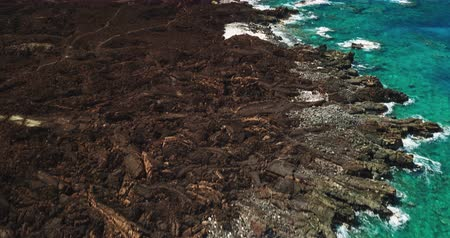 šnorchl : Aerial view over black lava flow and tropical blue ocean coral reef