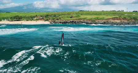 drone : Aerial view of windsurfer gliding across blue ocean