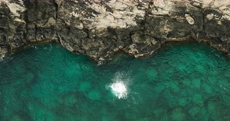cliff : Aerial view cliff jumping into ocean