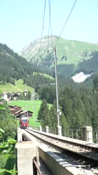 Langwies, GR  Switzerland - 24. July, 2019: the Rhaetian railway crosses the Langwies Viaduct over a deep ravine on the Chur - Arosa line