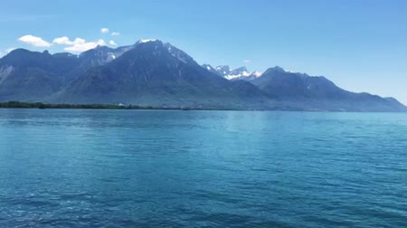 fortresses : Montreux, VD  Switzerland . 10 May, 2019: panorama view of the Swiss Alps and Lake Geneva with Chillon Castle and the Montreux Riviera