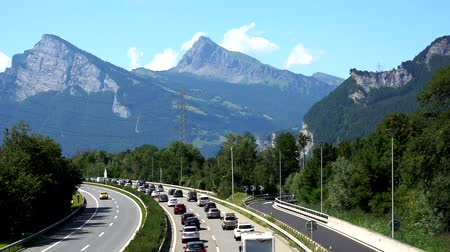 Maienfeld, GR  Switzerland - 4. August, 2019: heavy holiday bumper-to-bumper traffic on a highway in the Swiss Alps during summer vacation