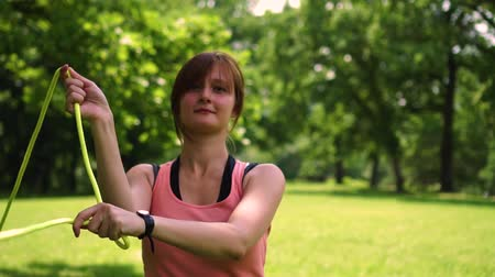 performer : girl turns poi in the park on the grass