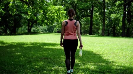girl athlete walks in the park