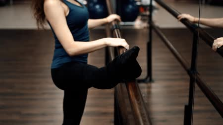 lovely girl does exercises in dance school