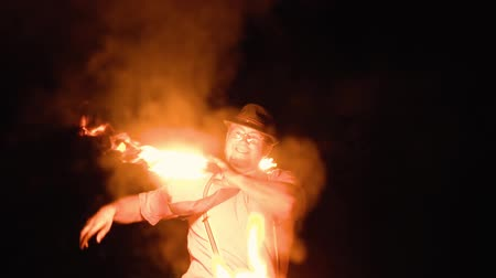 young man shows fire show