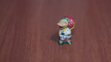 ducky : Duck toy housewife on a dark background Stock Footage