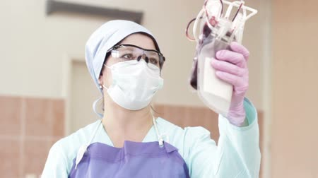 take blood : Nurse holding blood bag Stock Footage