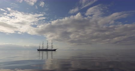 kotva : Sailing Ship. Old Four-Masted Barque In The Calm Mirror-Smooth Sea On The Background Of The Mountain Coast.