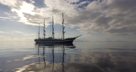 снасти : Sailing Ship. Old Four-Masted Barque In The Calm Mirror-Smooth Sea On The Background Of The Mountain Coast.