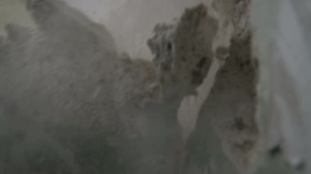 destruct : Smashing through concrete wall in slow motion Stock Footage